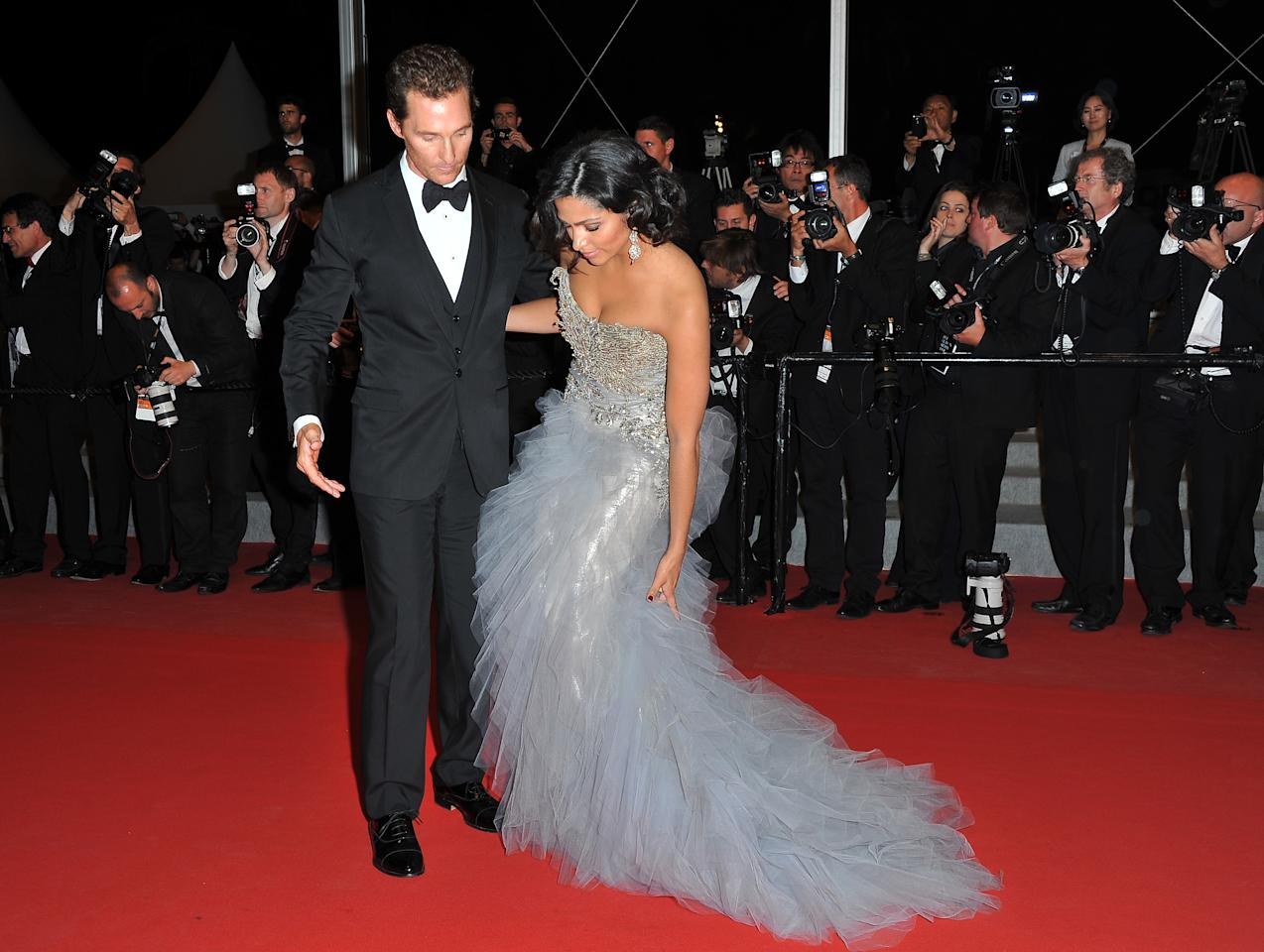 CANNES, FRANCE - MAY 26:  (L-R) Actor Matthew McConaughey and Camila Alves depart the 'Mud' Premiere during the 65th Annual Cannes Film Festival at Palais des Festivals on May 26, 2012 in Cannes, France.  (Photo by Pascal Le Segretain/Getty Images)