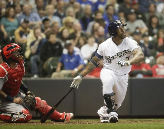 Milwaukee Brewers' Eric Thames hits a three-run scoring triple during the seventh inning of a baseball game against the St. Louis Cardinals Thursday, June 21, 2018, in Milwaukee. (AP Photo/Morry Gash)
