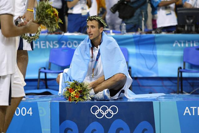 Manu Ginobili sits on the podium after doing the unthinkable: leading the Argentinian men's national basketball team to gold at the 2004 Summer Olympics in Athens, Greece. (Getty)