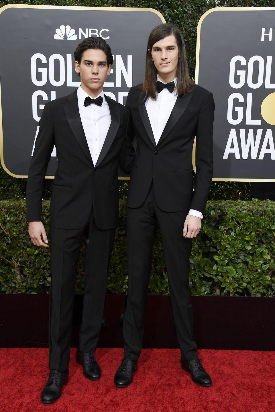 """<p>This year, Paris and Dylan Brosnan, the sons of Pierce Brosnan and Keely Shaye Smith, are serving as Golden Globes Ambassadors, the first time two brothers have been selected for the position.</p><p>""""We're proud to honor our dad's legacy as we join the incredible roster of previous Golden Globe Ambassadors, many of whom have gone on to pursue their own dreams in the entertainment industry,"""" <a href=""""https://www.hollywoodreporter.com/news/paris-dylan-brosnan-sons-pierce-brosnan-named-golden-globe-ambassadors-1254950"""" rel=""""nofollow noopener"""" target=""""_blank"""" data-ylk=""""slk:Dylan said last year, when the news that he and Paris would fill the role in 2020"""" class=""""link rapid-noclick-resp"""">Dylan said last year, when the news that he and Paris would fill the role in 2020</a>. </p><p>""""The biggest lesson our dad taught us is to 'be kind,' which was an essential factor in Paris and my decision to study filmmaking and our desire to tell important stories. Having this opportunity to turn the spotlight outward on kids experiencing hunger is a true privilege.""""</p>"""
