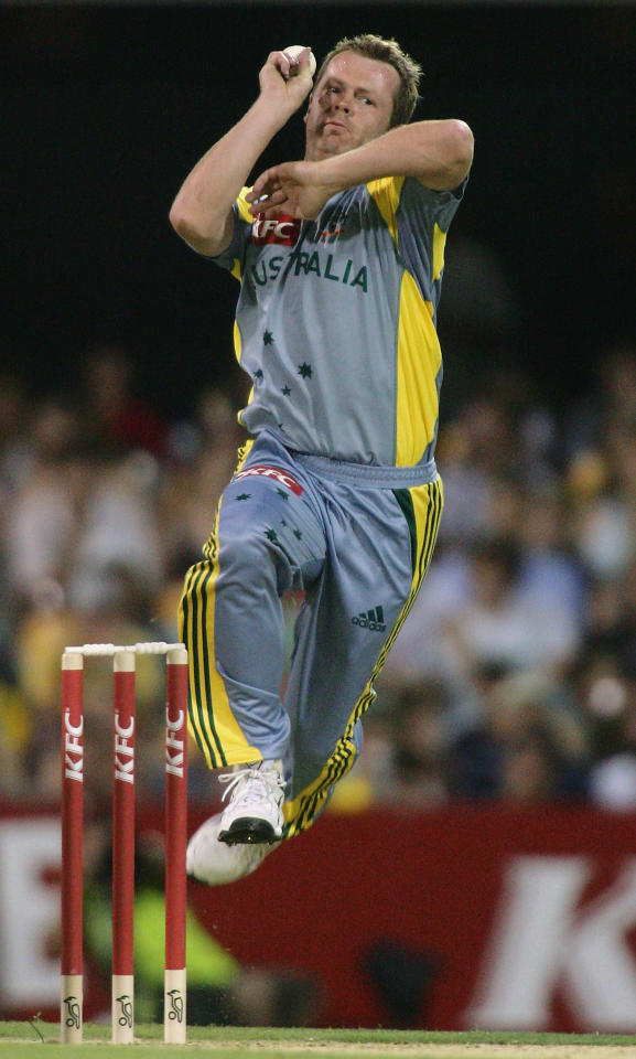 BRISBANE, QSL - JANUARY 09:  Mick Lewis of Australia in bowling action during the Twenty 20 Match between Australia and South Africa on January 9, 2006 at the Gabba in Brisbane, Australia.  (Photo by Jonathan Wood/Getty Images)