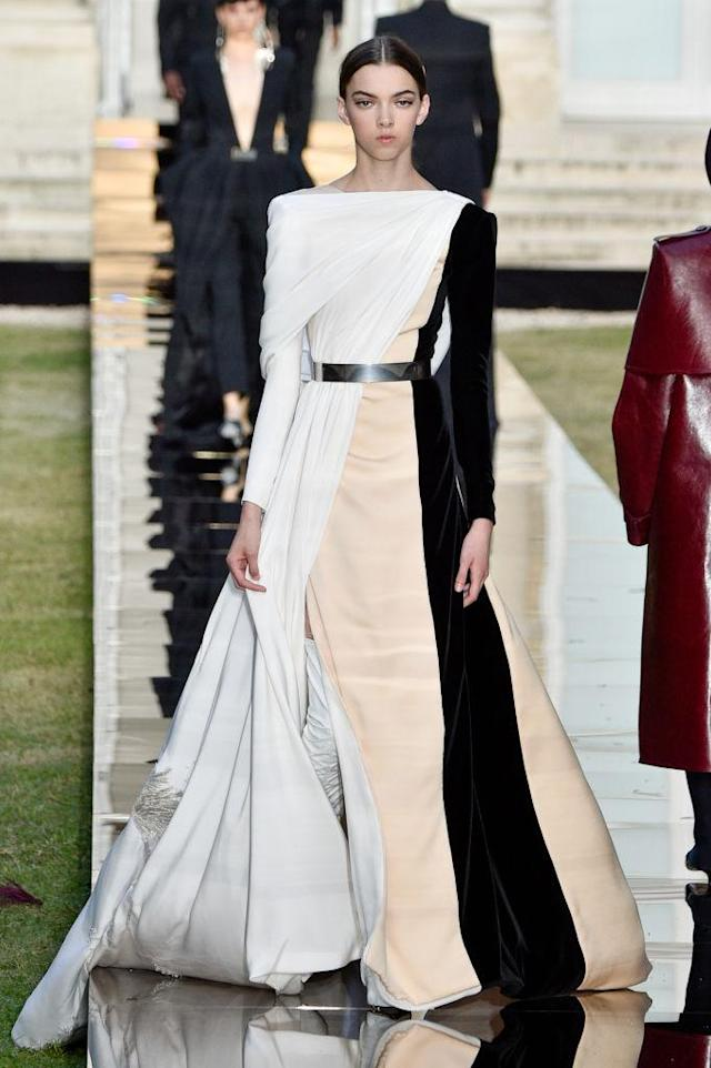 <p>Model wears a white, peach, and black contrast draped gown from the Givenchy fall 2018 couture collection. (Photo: Getty Images) </p>