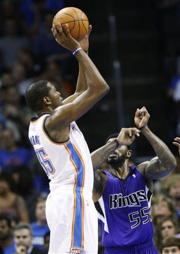 Oklahoma City Thunder forward Kevin Durant, left, shoots over Sacramento Kings guard Terrence Williams (55) in the second quarter of an NBA basketball game in Oklahoma City, Friday, April 13, 2012. (AP Photo/Sue Ogrocki)