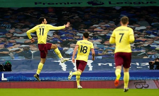 Dwight McNeil leaps in celebration of his goal in Burnley's win over Everton