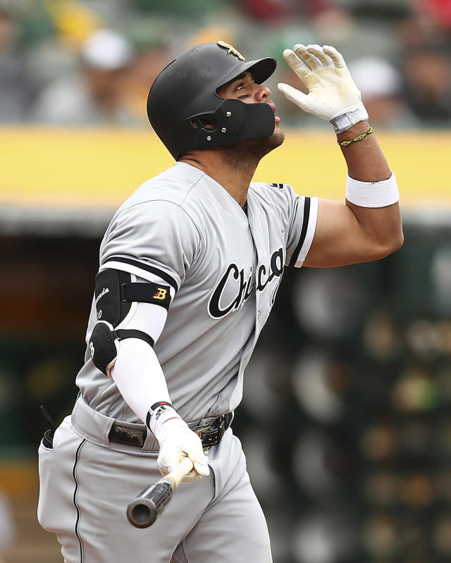 Chicago White Sox's Yoan Moncada watches his grand slam hit off Oakland Athletics pitcher Andrew Triggs during the second inning of a baseball game Wednesday, April 18, 2018, in Oakland, Calif. (AP Photo/Ben Margot)