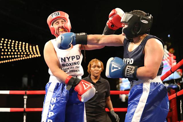 <p>New York's police officer Selina Herrera connects with a right cross off the chin of police officer Radwa Mohammed during the NYPD Boxing Championships at the Theater at Madison Square Garden on June 8, 2017. (Photo: Gordon Donovan/Yahoo News) </p>