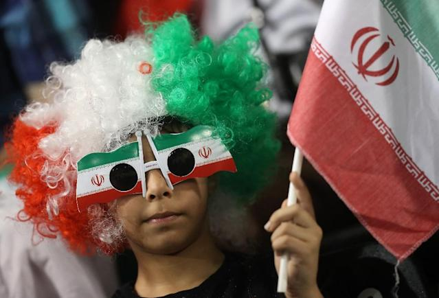 An Iranian fan waves his national flag during a World Cup 2018 Asia qualifying football match between Qatar and Iran at the Jassim Bin Hamad stadium in Doha on March 23, 2017 (AFP Photo/KARIM JAAFAR)