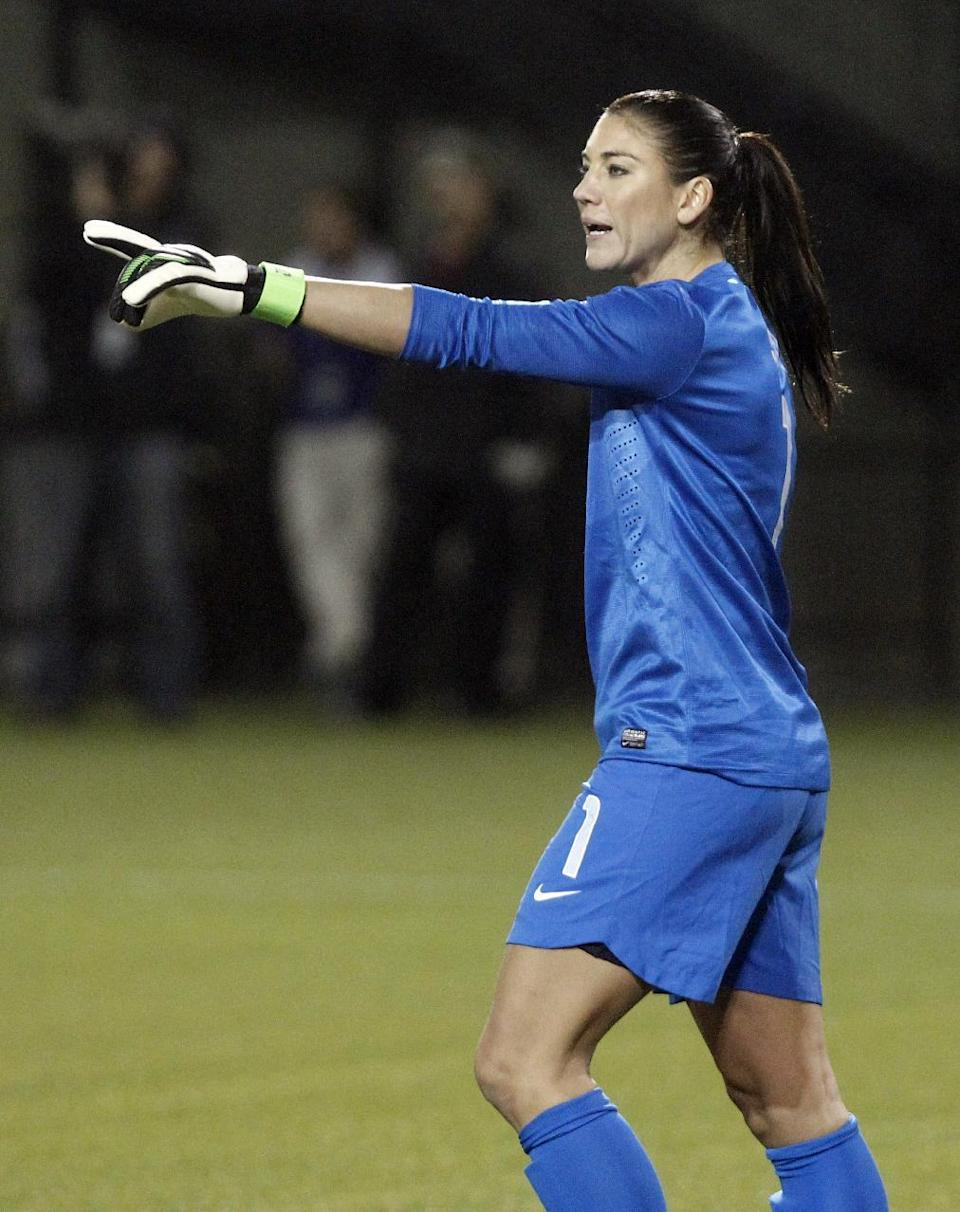 United States goalie Hope Solo directs her defenders during the first half of an exhibitionsoccer match against Ireland in Portland, Ore., Wednesday, Nov. 28, 2012. (AP Photo/Don Ryan)