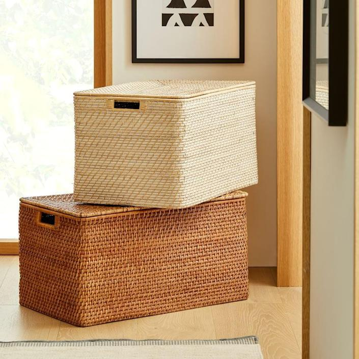 <p>If you want to keep your books out of sight, go with the <span>West Elm Modern Weave Lidded Storage Baskets</span> ($150).</p>