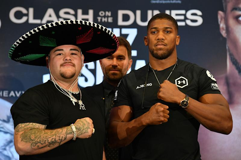 "Mexican-US WBA, IBF, WBO and IBO heavyweight boxing champion Andy Ruiz Jr (L) and Britain's Anthony Joshua (R) pose next to each other at a promotional press conference for the ""Clash on the Dunes"" fight, set to take place in December, in London on September 6, 2019. - The ""Clash on the Dunes"" is scheduled to take place in Diriya, Saudi Arabia on December 7. (Photo by DANIEL LEAL-OLIVAS / AFP) (Photo credit should read DANIEL LEAL-OLIVAS/AFP/Getty Images)"