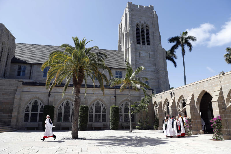 Clergy line up to enter for services at the Episcopal Church of Bethesda-by-the-Sea, where President Donald Trump and family are attending Easter services, Sunday, April 16, 2017, in Palm Beach, Fla. (AP Photo/Alex Brandon)