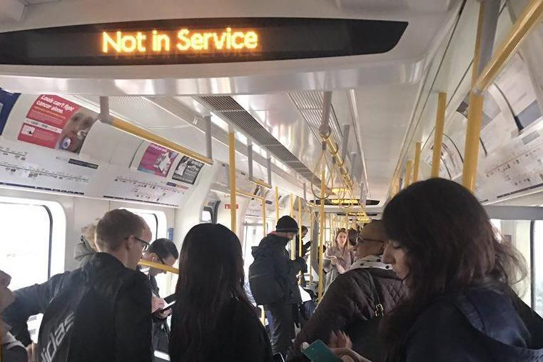 Not in service: Passengers were locked inside the train. (@SJNeve - Daily Mail)