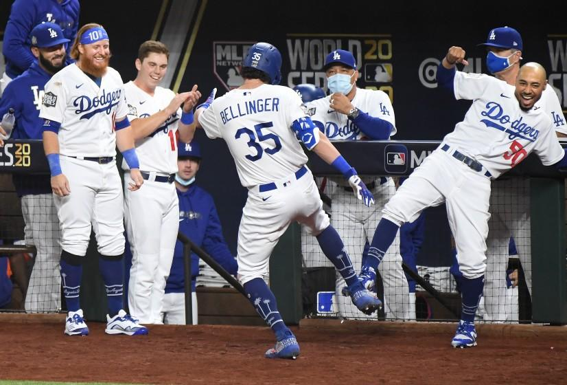 ARLINGTON, TEXAS OCTOBER 20, 2020-The Dodgers dugout celebrates Cody Bellinger's two-run home run against the Rays in the 4th inning in Game 1 of the World Series at Globe Life Field in Arlington, Texas Tuesday. (Wally Skalij/Los Angeles Times)