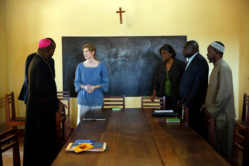 US Ambassador to the United Nations Samantha Power, center left, meets with Bangui's Archbishop Dieudonne Nzapala Inga, foreground left, Imam Oumar Kobine Layama, foreground right, at the Notre Dame cathedral in Bangui, Central African Republic, Thursday, Dec. 19, 2013. Power is on a one day trip to the war stricken region. (AP Photo/Jerome Delay)