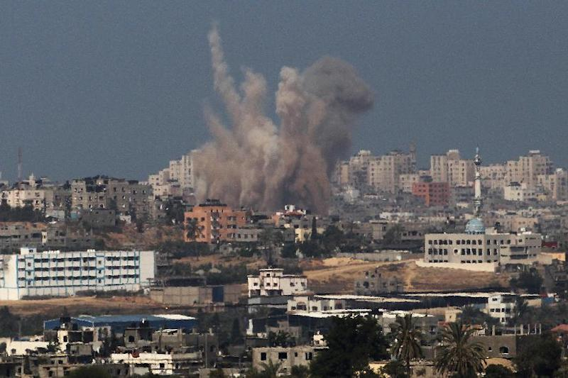 Smoke and dust rise from the coastal side of the Gaza strip following an Israeli military strike on August 20, 2014
