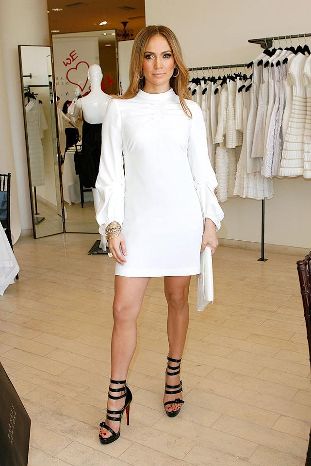 "Jennifer Lopez rocked a white mini dress and sky-high Christian Louboutin 123 platform sandals at the launch of Andrea Lieberman's A.L.C. collection at Barneys in LA. Donato Sardella/<a href=""http://www.wireimage.com"" target=""new"">WireImage.com</a> - February 18, 2009"