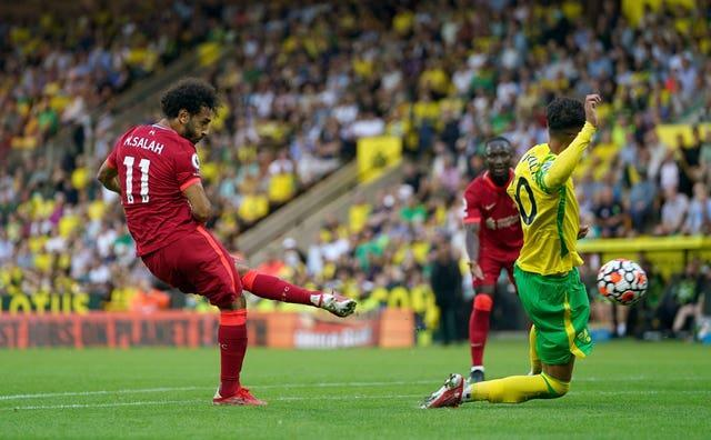 Salah (left) scored Liverpool's third goal when they opened their Premier League campaign with a 3-0 win at Norwich on August 14 (Joe Giddens/PA).