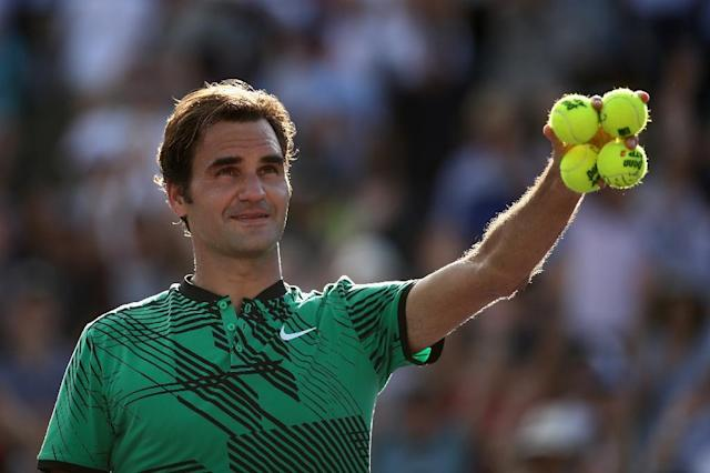 Roger Federer of Switzerland celebrates after defeating Tomas Berdych of Czech Republic in their Miami Open quarter-final match, at Crandon Park Tennis Center in Key Biscayne, on March 30, 2017 (AFP Photo/Julian Finney)