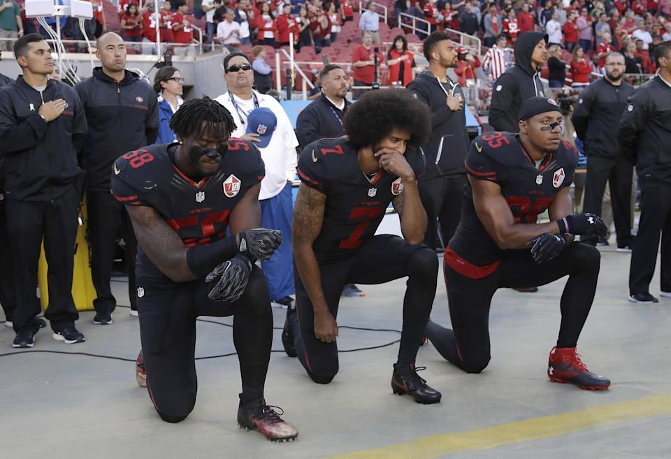 Colin Kaepernick (center) could finally have a chance to start at QB again for the San Francisco 49ers. (AP)
