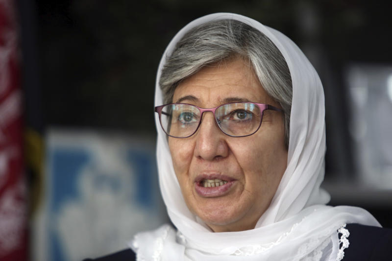 FILE - In this April 7, 2018, file photo, Dr. Sima Samar, chairperson of Afghanistan's Independent Human Rights Commission, speaks during an interview with The Associated Press in Kabul, Afghanistan. Afghan rights workers, including Sama, are warning that U.S. National Security Adviser John Bolton's blistering attack on the International Criminal Court investigating war crimes allegations will strengthen a climate of impunity in Afghanistan, prolong the war and embolden those carrying out acts of violence. In a speech Monday, Bolton said Washington would not cooperate with The Hague-based court and threatened it with sanctions, saying it put U.S. sovereignty and national security at risk. (AP Photo/Rahmat Gul, File)