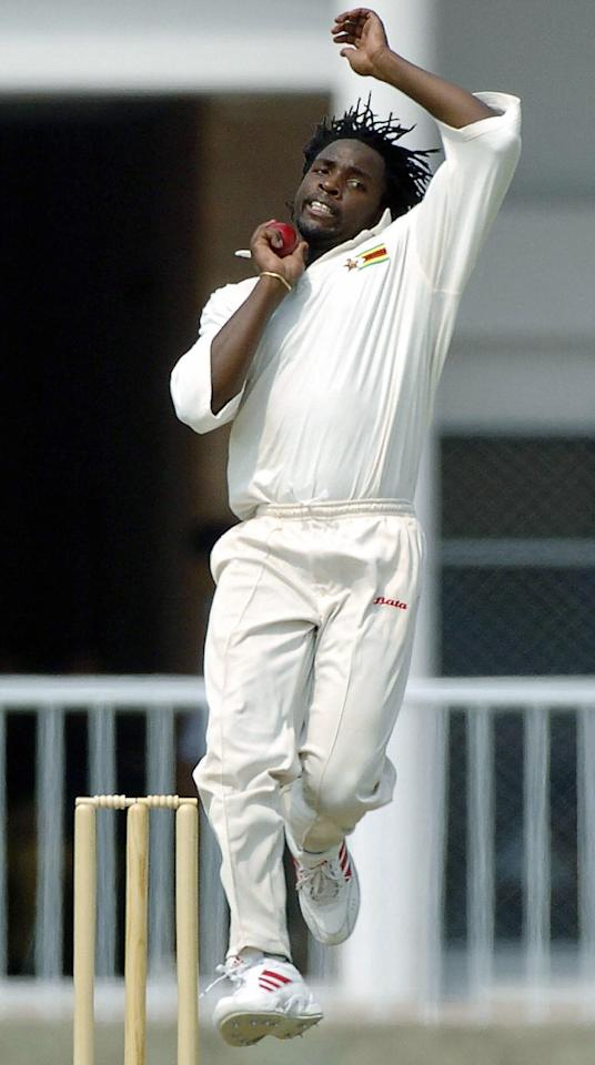 SHEIKUPURA, PAKISTAN:  Zimbabwe bowler Douglas Hondo delivers a ball during the second day of the two day match between Zimbabwe and Pakistan's Chairman XI in Sheikupura, 21September 2004.  Pakistan Cricket Board Chairman XI made 398 runs for the loss of two wickets in their first innings. AFP PHOTO/Arif ALI  (Photo credit should read ARIF ALI/AFP/Getty Images)