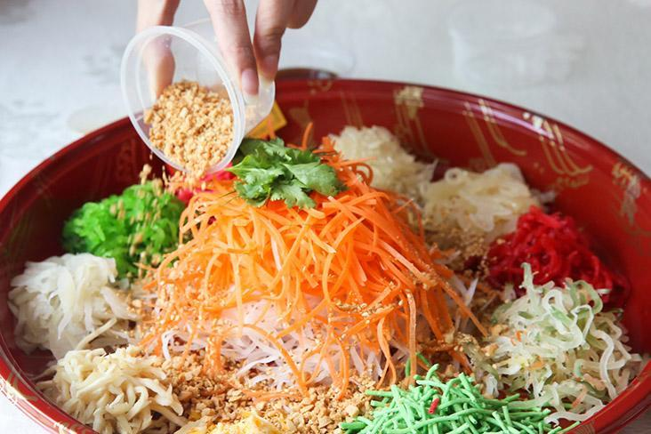 It's fun to toss 'yee sang' at home as you can be as loud as you wish or make a mess by tossing it high.