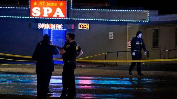 PHOTO: Law enforcement officials gather outside a spa following a shooting, March 16, 2021, in Atlanta. (Brynn Anderson/AP)