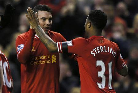Liverpool's Iago Aspas celebrates his goal with teammate Raheem Sterling during their FA Cup third round soccer match against Oldham Athletic at Anfield in Liverpool January 5, 2014. REUTERS/Phil Noble