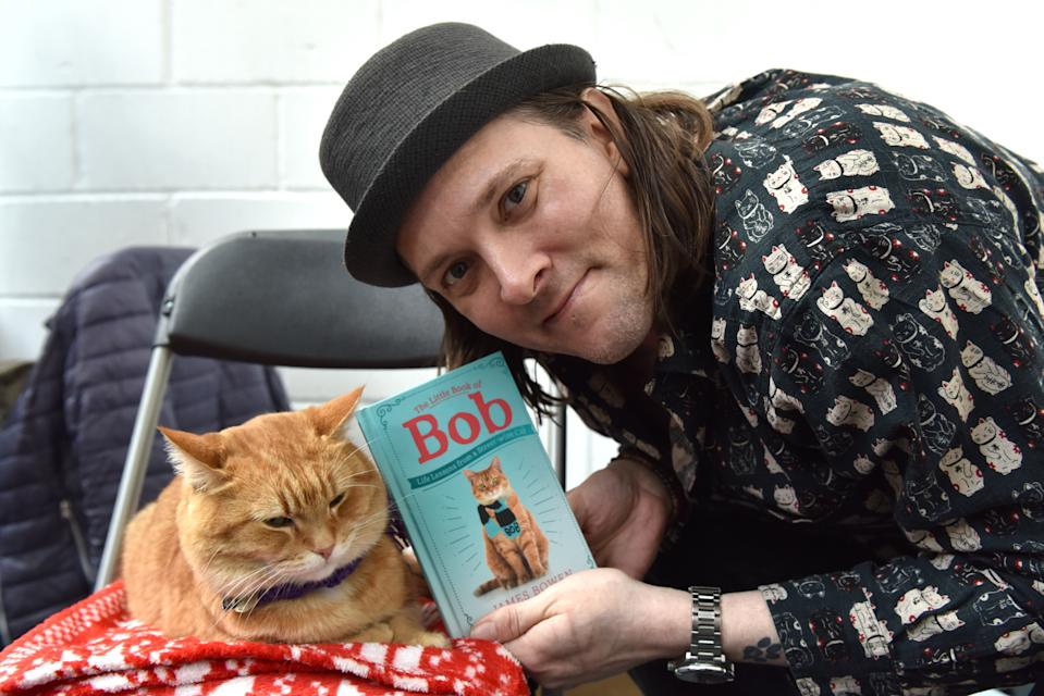 LONDON, ENGLAND - MAY 04: Author James Bowen and his Street Cat Named Bob attend the LondonCats International Show and Expo at Tabacco dock on May 04, 2019 in London, England. LondonCats is an official TICA Cat Show, international competition with over 200 cats judges from across the world. (Photo by John Keeble/Getty Images)