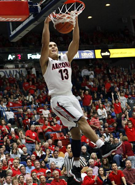 FILE - Arizona's Nick Johnson dunks against Southern Mississippi during the second half of an NCAA college basketball game at McKale Center in Tucson, Ariz., in this Dec. 4, 2012 file photo. As the college basketball season nears its midpoint, the player of year honor appears to be up for grabs with roughly two dozen players who could be considered the best in the country. Nick Johnson is among a Pick 6 of players having outstanding seasons so far. (AP Photo/Wily Low, File)