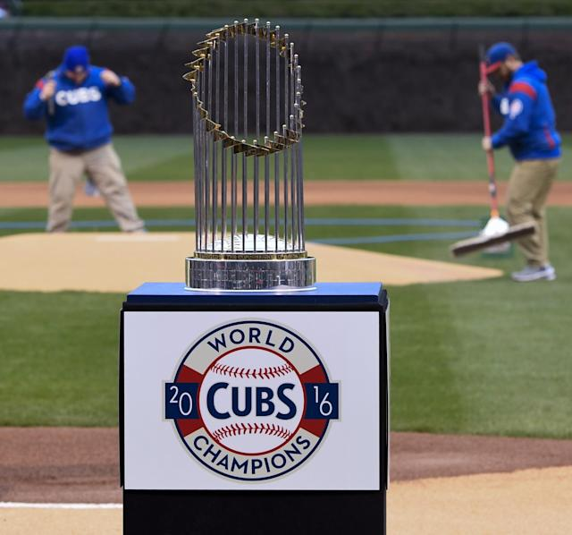 Some of the flags atop the Cubs' World Series trophy were reportedly broken off during Theo Epstein's charity concert. (AP Photo/Matt Marton)