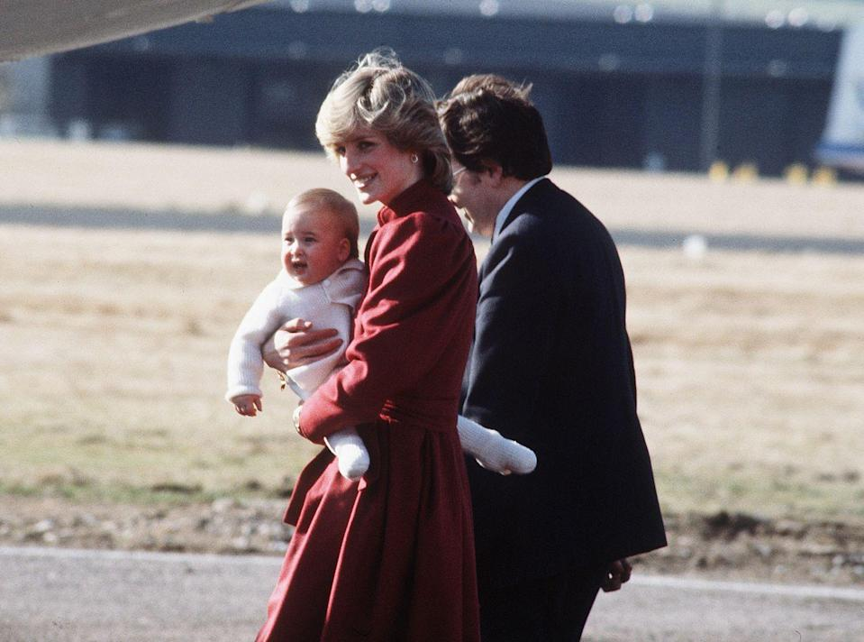 <p>Diana holding a young wearing Prince Wiliiam as they arrive at Aberdeen Airport on their way to Balmoral.<br></p>