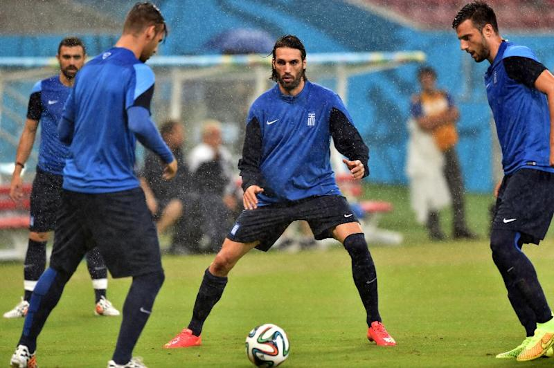 Greece striker Georgios Samaras (C) practices with team-mates during a training session at Pernambuco Arena in Recife, Brazil on June 28, 2014, a day before their 2014 World Cup last 16 match against Costa Rica