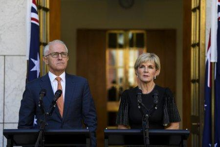 Australian Prime Minister Malcolm Turnbull and Australian Foreign Minister Julie Bishop speak to the media during a news conference at Parliament House in Canberra, Australia, March 27, 2018. AAP Image/Lukas Coch/via REUTERS