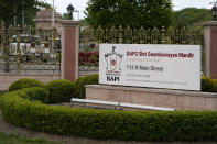 The entrance to the BAPS Shri Swaminarayan Mandir is seen in Robbinsville Township, N.J., Tuesday, May 11, 2021. Workers from marginalized communities in India were lured to the U.S. and forced to work long hours for just a few dollars per day to help build the Hindu temple in New Jersey, according to a lawsuit filed Tuesday, May 11, 2021. The lawsuit, filed in federal court, accuses the leaders of the Hindu organization known as Bochasanwasi Akshar Purushottam Swaminarayan Sanstha, or BAPS, of human trafficking and wage law violations. (AP Photo/Seth Wenig)