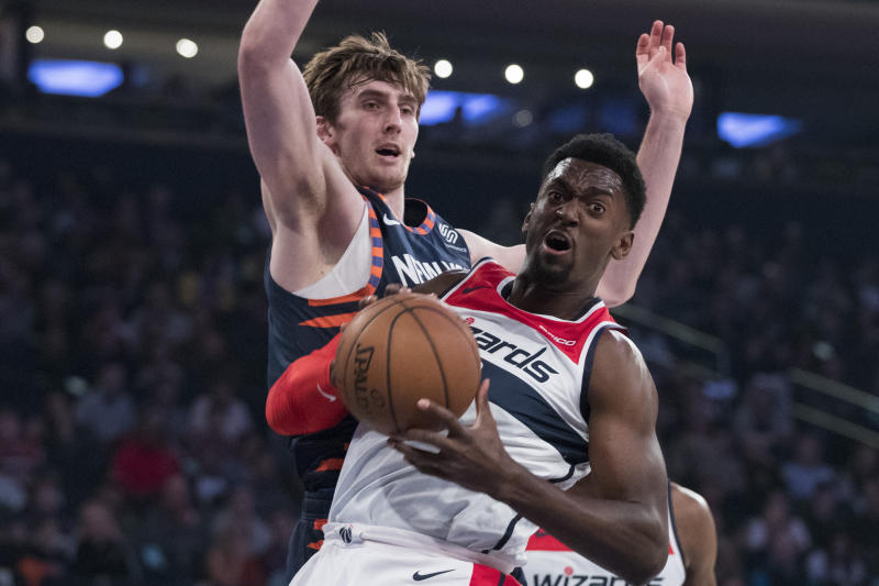 New York Knicks forward Luke Kornet, background, guards Washington Wizards forward Bobby Portis during the first half of an NBA basketball game, Sunday, April 7, 2019, at Madison Square Garden in New York. (AP Photo/Mary Altaffer)