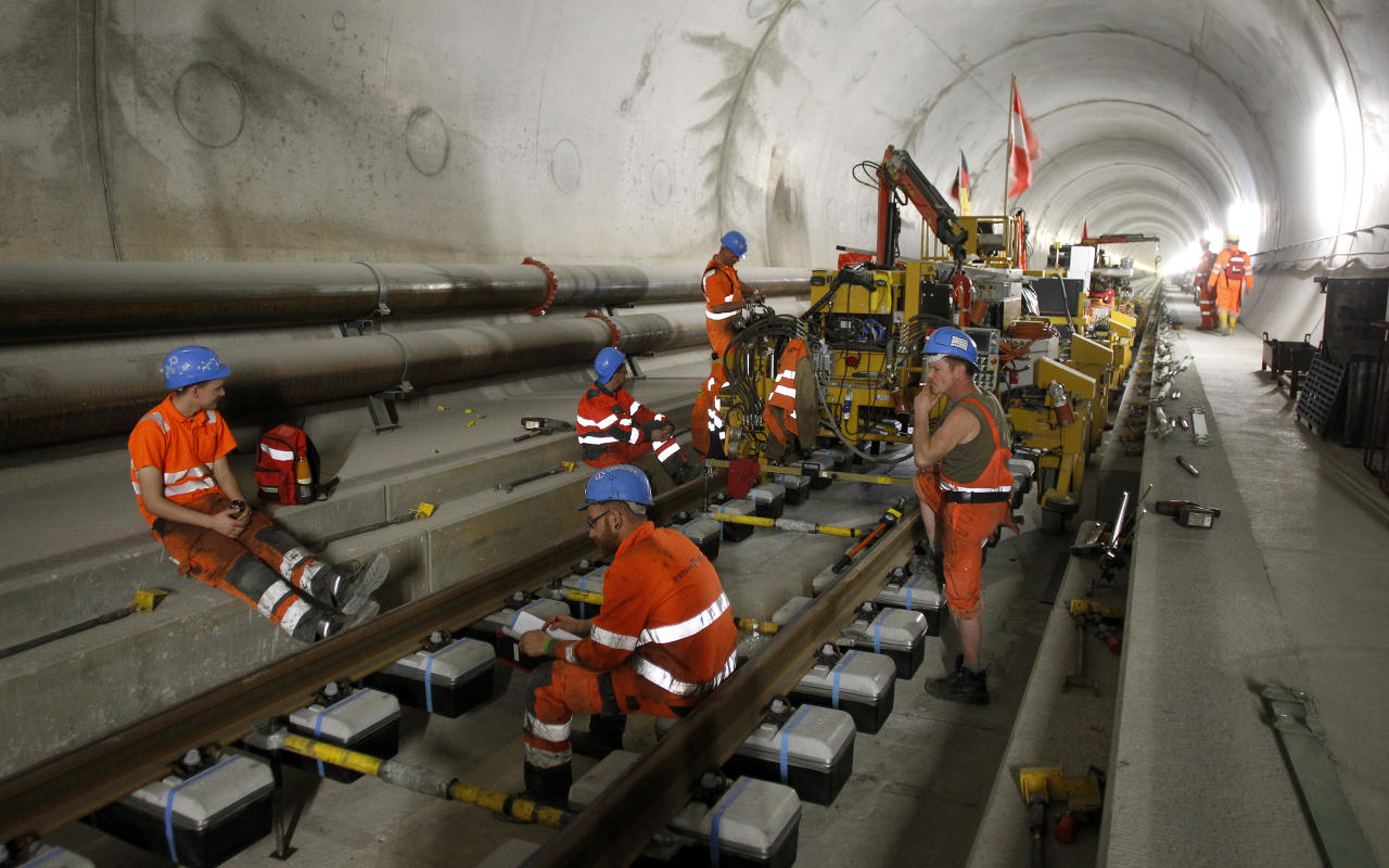 Workers have a break during the installation of the railway tracks in the NEAT Gotthard Base tunnel near Erstfeld May 7, 2012. Crossing the Alps, the world's longest train tunnel should become operational at the end of 2016. The project consists of two parallel single track tunnels, each of a length of 57 km (35 miles)  REUTERS/Arnd Wiegmann   (SWITZERLAND - Tags: BUSINESS CONSTRUCTION EMPLOYMENT TRAVEL) - RTR31QEL