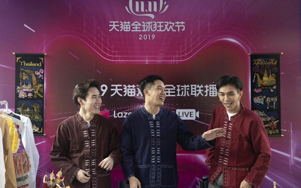 Merchants selling their products speak inside a live stream booth during Alibaba's annual Singles' Day online shopping event - Qilai Shen /Bloomberg