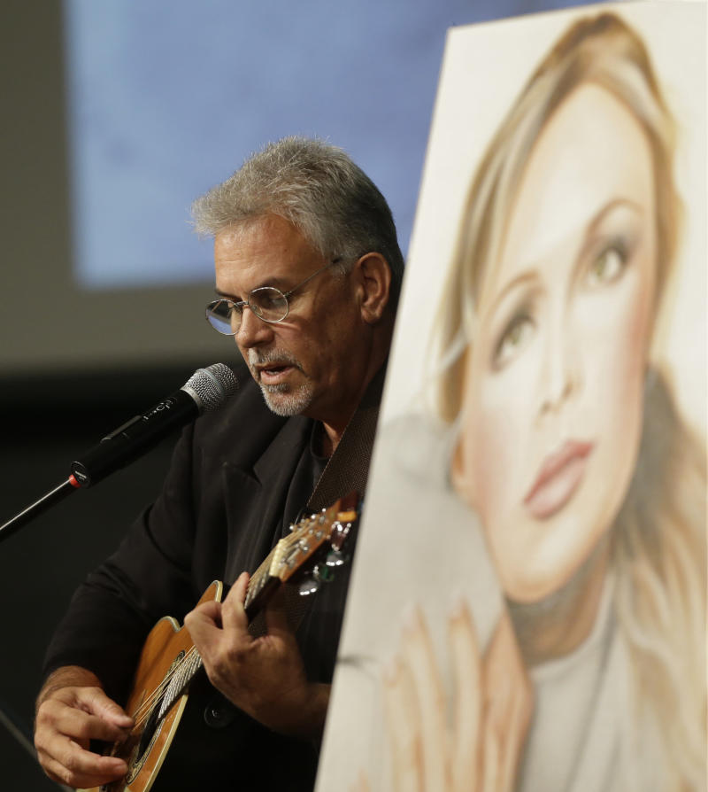 Michael Inge, stepfather of country music star Mindy McCready, plays a song during the funeral ceremony at the Crossroads Baptist Church in Fort Myers, Fla., Tuesday, Feb. 26, 2013.  McCready committed suicide Feb. 17 at her home in Arkansas, days after leaving a court-ordered substance abuse program. (AP Photo/Alan Diaz)