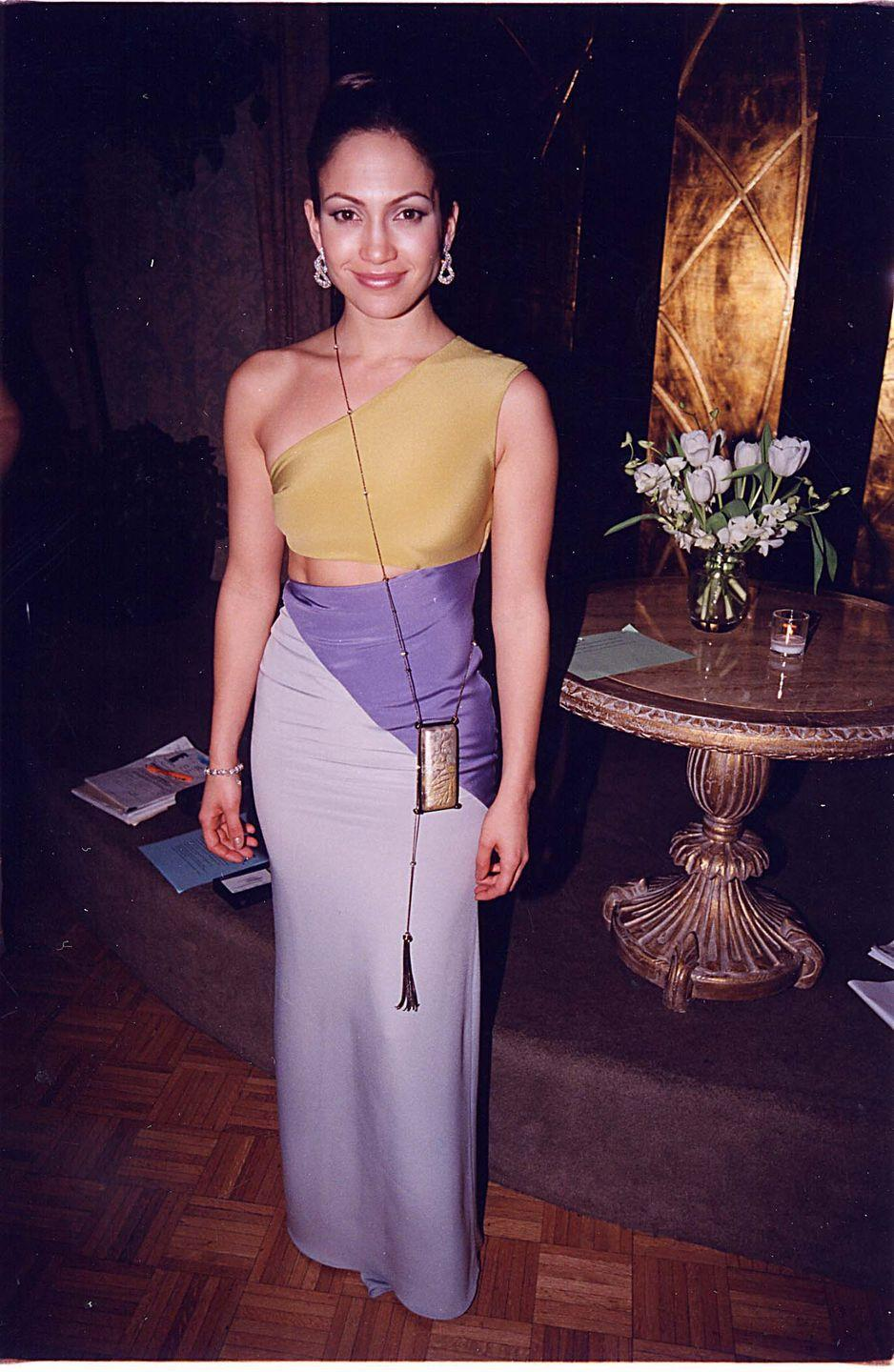 <p>The '90s were associated with severe minimalism (think spaghetti-strap tank tops, slip dresses, mules, etc.), including super thin-strapped cross-body bags, much like Jennifer Lopez's here. </p>