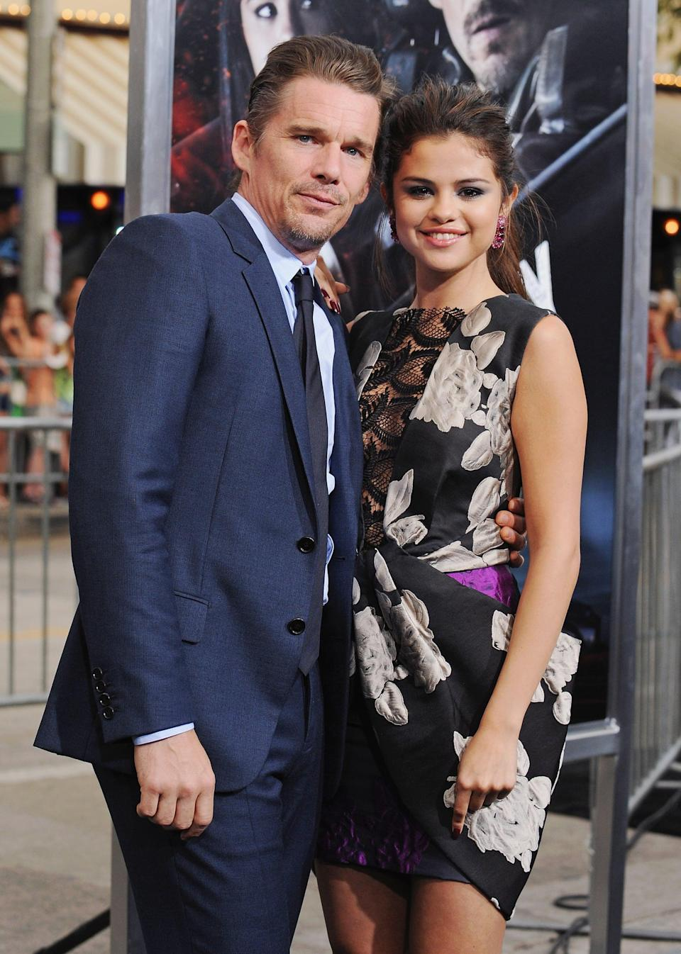"""<p>Selena walked the red carpet with <a class=""""link rapid-noclick-resp"""" href=""""https://www.popsugar.com/Ethan-Hawke"""" rel=""""nofollow noopener"""" target=""""_blank"""" data-ylk=""""slk:Ethan Hawke"""">Ethan Hawke</a> at the LA premiere of their action flick, <b>Getaway</b>.</p>"""
