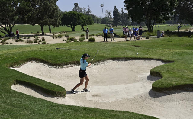 Cheyenne Knight hits out of a bunker on the fourth hole during the first round of the HUGEL-Air Premia LA Open golf tournament at Wilshire Country Club Thursday, April 25, 2019, in Los Angeles. (AP Photo/Mark J. Terrill)