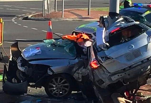 The wreckage of the allegedly stolen car, wrapped around a pole in Rothwell, north of Brisbane.