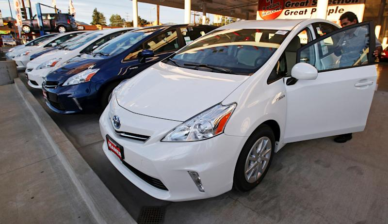 An employee parks a Toyota gas-electric hybrid automobile in a row of similar cars at a dealership in Los Angeles Thursday, Jan. 26, 2012. (Photo: ASSOCIATED PRESS)