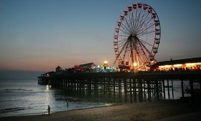 Seaside resorts such as Blackpool in northwest England have enjoyed a mini-revival from staycations after coronavirus restrictions were lifted (AFP/Paul ELLIS)