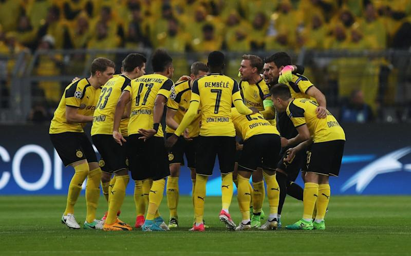 The Dortmund players huddle prior to the UEFA Champions League Quarter Final first leg match between Borussia Dortmund and AS Monaco at Signal Iduna Park - Credit: Getty Images