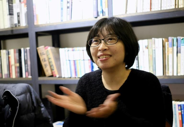 "Huang Hui-chen, director of ""Small Talk"", gestures during an interview at a cafe in Taipei"