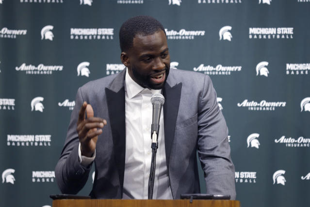 Former Michigan State and current Golden State Warriors player Draymond Green talks to reporters before an NCAA college basketball game between Michigan State and Duke, Tuesday, Dec. 3, 2019, in East Lansing, Mich. (AP Photo/Al Goldis)