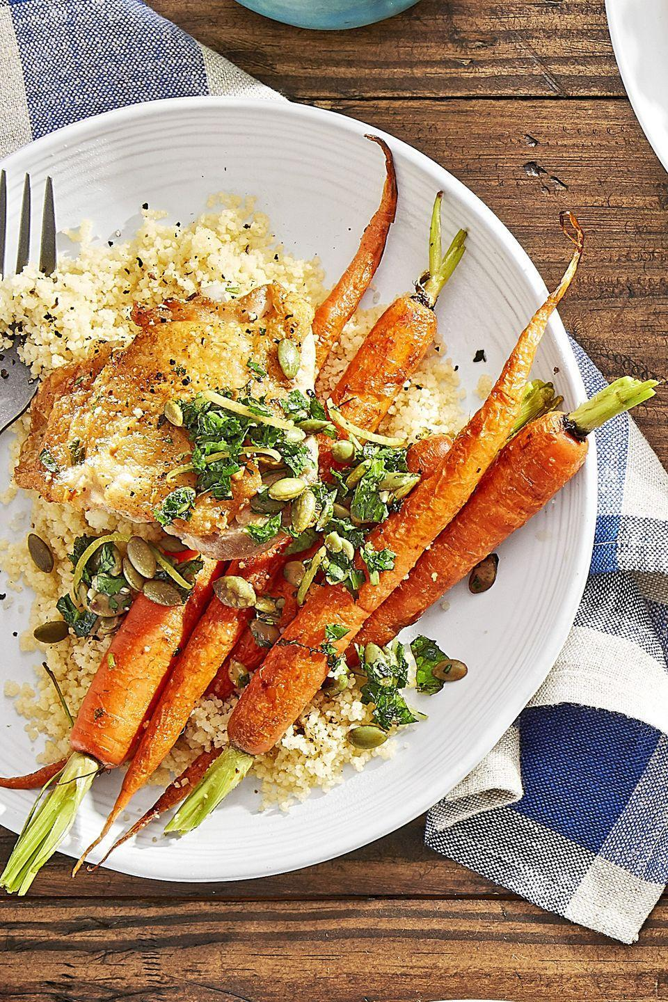 """<p>Who knew that roasting carrots whole could look so pretty? Especially when served with golden chicken thighs and fluffy couscous.</p><p><strong><a href=""""https://www.countryliving.com/food-drinks/recipes/a44273/crispy-chicken-roasted-carrots-couscous-recipe/"""" rel=""""nofollow noopener"""" target=""""_blank"""" data-ylk=""""slk:Get the recipe"""" class=""""link rapid-noclick-resp"""">Get the recipe</a>.</strong></p>"""