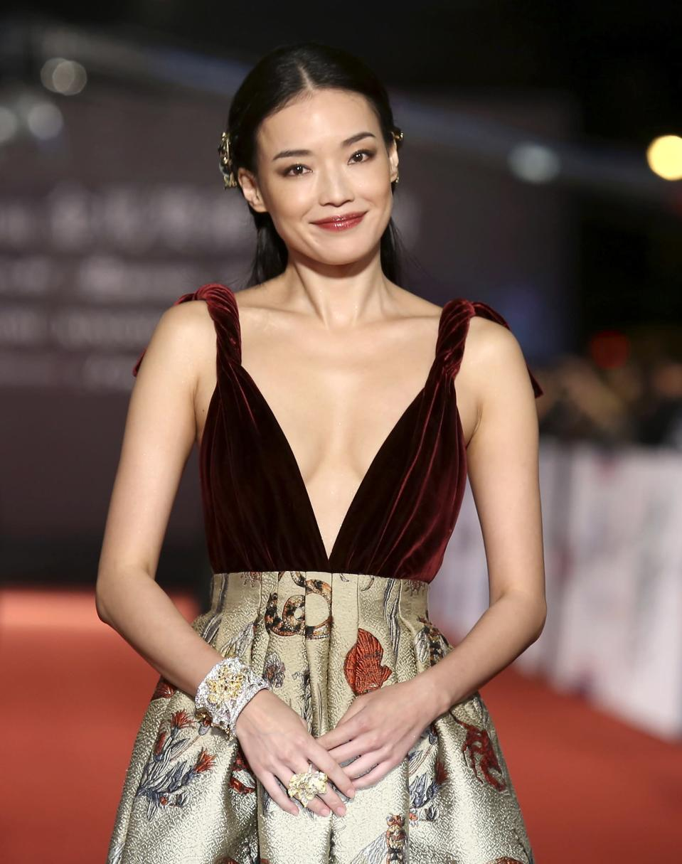 Taiwanese actress Shu Qi poses for photographers on the red carpet at the 50th Golden Horse Film Awards in Taipei November 23, 2013. REUTERS/Patrick Lin (TAIWAN - Tags: ENTERTAINMENT)